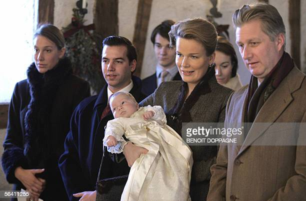 Prince Philippe and Princess Mathilde hold their son Prince Emmanuel during his baptism 10 December 2005 at the chapel of the Castle of Ciergnon...