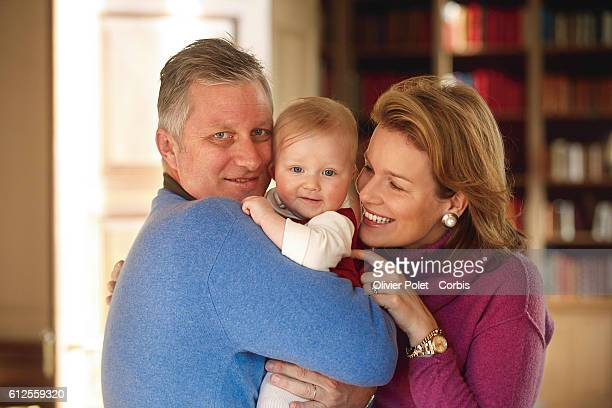 Prince Philippe and Princess Mathilde of Belgium share a moment with their daughter Eleonore in the lounge of their winter apartment.