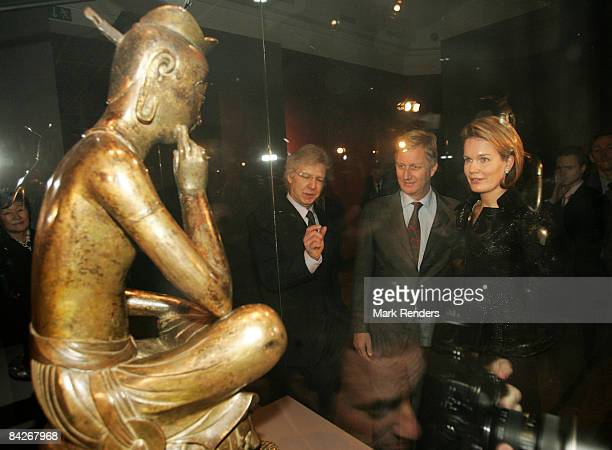 Prince Philippe and Princess Mathilde of Belgium view an exhibit during their visit to the Le Sourire de Bouddha exhibition at the Palais des...