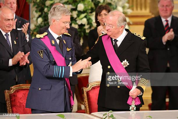 Prince Philippe of Belgium and father King Albert II of Belgium seen at the Abdication Ceremony Of King Albert II Of Belgium Inauguration Of King...