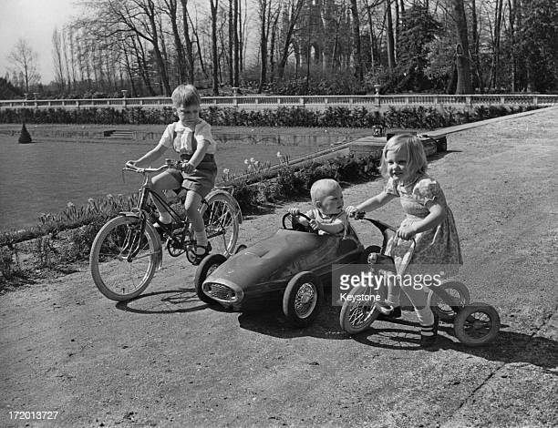 Prince Philippe of Belgium and Princess Astrid of Belgium play with their younger brother Prince Laurent of Belgium in the grounds of the Chateau...