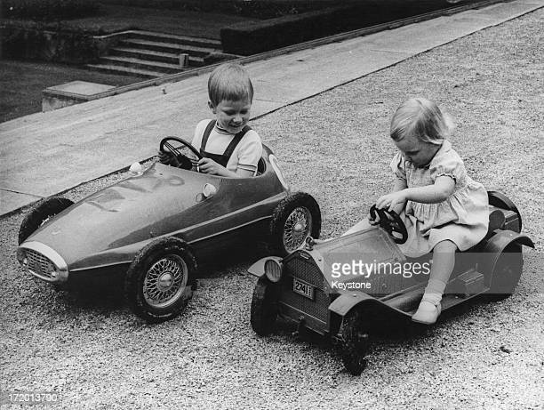 Prince Philippe of Belgium and Princess Astrid of Belgium play with their new toys at the Royal Palace of Laeken Brussels 1965