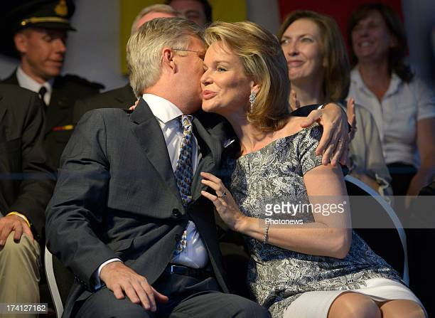 Prince Philippe of Belgium and Princess Mathilde of Belgium kiss each other on the cheek as they attend an evening of concerts the 'Bal National' in...