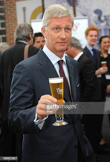 Prince Philippe of Belgium drinks a Crown Lager beer at Carlton BrewHouse on November 26 2012 in Melbourne Australia Prince Philippe is on a tenday...