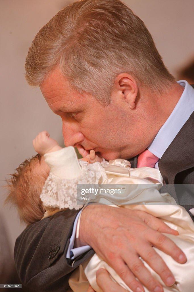 Prince Philippe of Belgium kisses his daughter Princess Eleonore of Belgium during her baptism at the Chapel of Ciergnon Castle on June 14, 2008 in Ciergnon, Belgium.