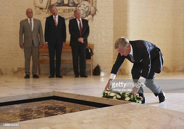 Prince Philippe of Belgium lays a wreath at the Tomb of the Unknown Australian Soldier during a tour of The Australian War Memorial on November 23...
