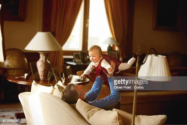 Prince Philippe of Belgium shares a moment with Princess Eleonore in the lounge of their winter apartment