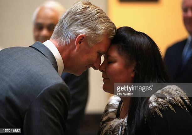 Prince Philippe of Belguim shares a traditional maori greeting of a hongi with Marama Royal at the Auckland War Memorial Museum on November 28 2012...