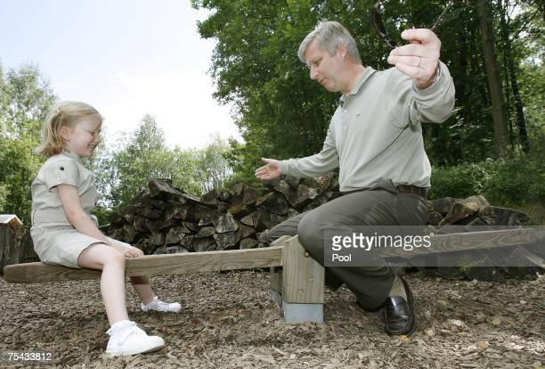 Prince Philippe plays with Princess Elisabeth of Belgium during a walk in Park Chlrophylle on July 16 in Dochamps Belgium