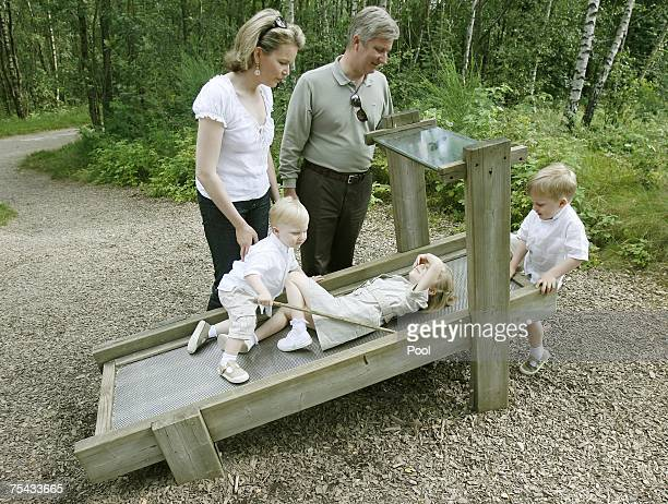Prince Philippe Princess Mathilde of Belgium and their children Princess Elisabeth Prince Gabriel and Prince Emmanuel of Belgium walk in Park...