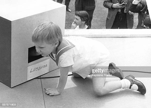 Prince Philippe takes the winning numbers at the festival in Heysel organized for the 100th bithday of the Red Cross circa 1960 in Brussels Belgium