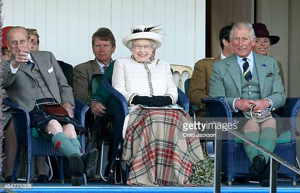 Prince Phillip Duke of Edinburgh Queen Elizabeth II and Prince Charles Prince of Wales watch the action during the Braemar Highland Games on...