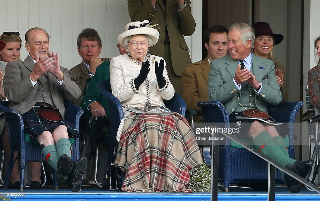 Prince Phillip, Duke of Edinburgh, Queen Elizabeth II and Prince Charles, Prince of Wales watch the action during the Braemar Highland Games on September 6, 2014 in Braemar, Scotland. The Braemar Gathering is the most famous of the Highland Games and is known worldwide. Each year thousands of visitors descend on this small Scottish village on the first Saturday in September to watch one of the more colourful Scottish traditions. The Gathering has a long history and in its modern form it stretches back nearly 200 years
