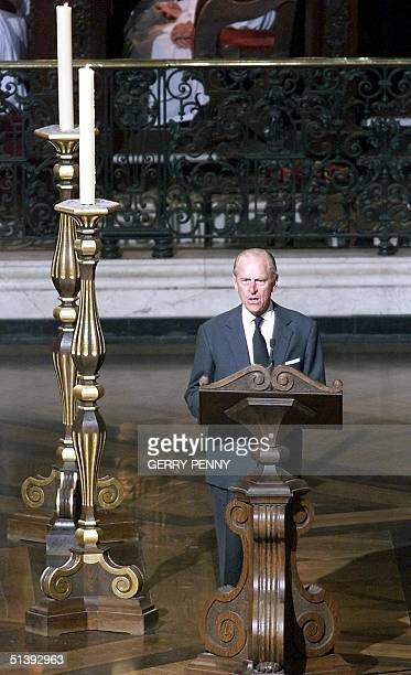 Prince Phillip Duke of Edinburgh reads from the New Testament 14 September 2001 at St Pauls Cathedral during a special hour long service to honour...