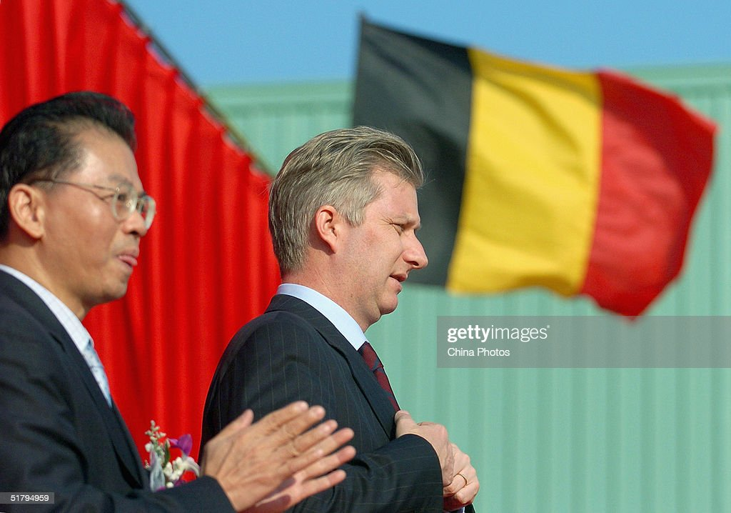 Prince Phillipe of Belgium (R) attends an opening ceremony of a factory of Belgium's Vitalo Packaging Co. Ltd. on November 26, 2004 in Guangzhou, China. Belgium is China's sixth largest European trade partner.