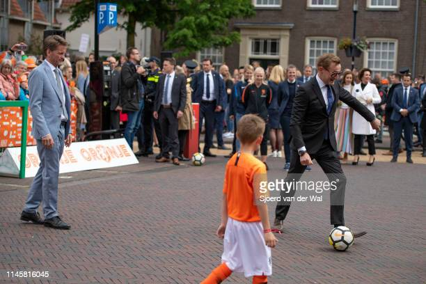 Prince PieterChristiaan of The Netherlands and Prince Bernhard of The Netherlands participating in a game of soccer during the Kingsday celebrations...