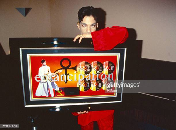 Prince poses during his 'Emancipation' album release party at Life on February 27 1997 in New York City