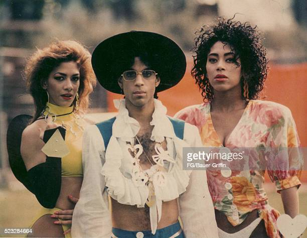 Prince poses with Sheila E. And Cat during his Love Sexy '88 Tour at Feijenoord Stadion in 1988 in Rotterdam, Netherlands.