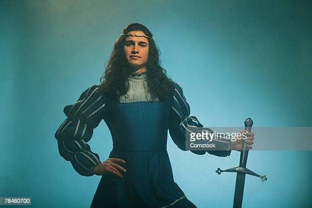 Prince posing confidently with sword