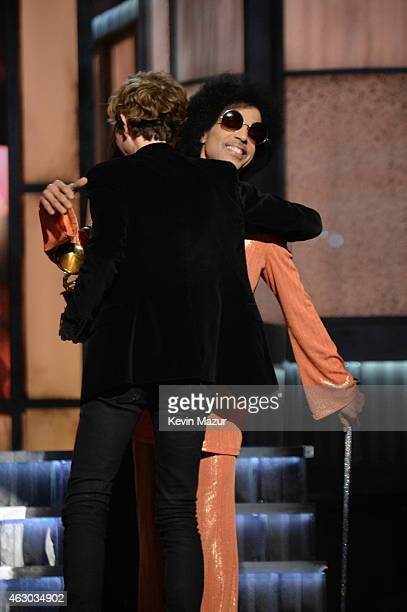 Prince presents award to Beck onstage during The 57th Annual GRAMMY Awards at the STAPLES Center on February 8, 2015 in Los Angeles, California.