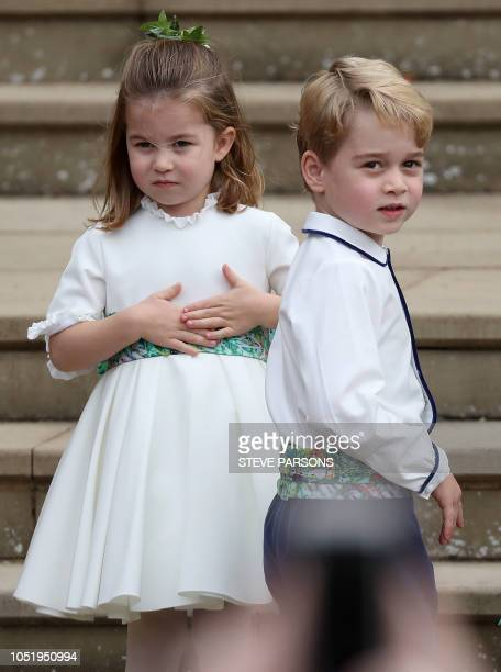 TOPSHOT Prince Prince George and his sister Princess Charlotte arrive to attend the wedding of Britain's Princess Eugenie of York to Jack Brooksbank...