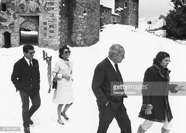 Prince Radziwill talking to film director Roman Polanski while his wife, Princess Lee Radziwill, talks to producer Gene Gutowski , walking through...