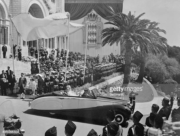 Prince Rainier and Princess Grace are driven from the Cathedral of St. Nicholas in an open rolls Royce here on April 19th. After the religious...