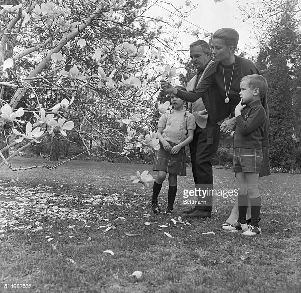 Prince Rainier and Princess Grace of Monaco look at tree blossoms with their son Albert and their daughter Caroline while on vacation in Philadelphia
