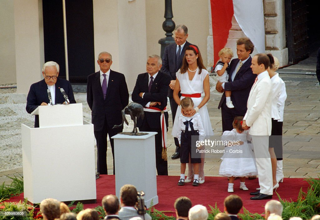 Prince Rainier III addresses a crowd outside the Palais du Prince during an anniversary celebration commemorating 40 years as ruler of Monaco. Standing beside him are his son Crown Prince Albert, daughter Princess Caroline, her husband Stefano Casiraghi, and grandchildren.