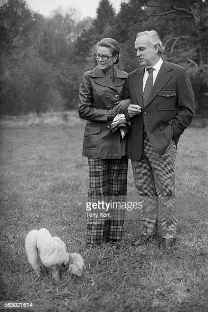 Prince Rainier III and Princess Grace of the Grimaldi royal family take a walk in the countryside