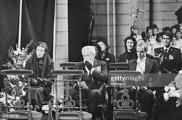Prince Rainier III grieves with his children, Princess Caroline and Crown Prince Albert, during the funeral mass of his wife, Princess Grace, at the...
