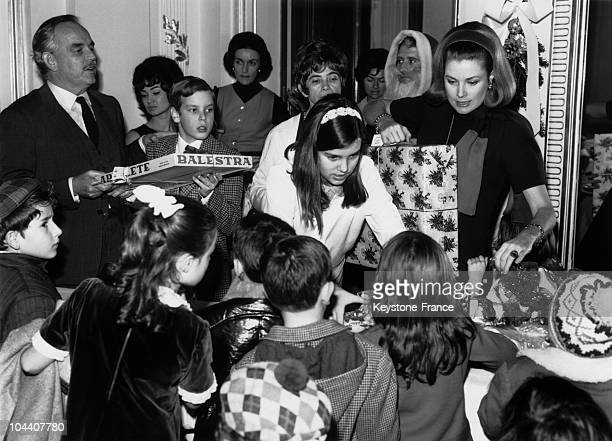 Prince RAINIER III his son ALBERT his daughter CAROLINE and his wife GRACE are distributing Christmas presents to Monegasque children in Monaco royal...