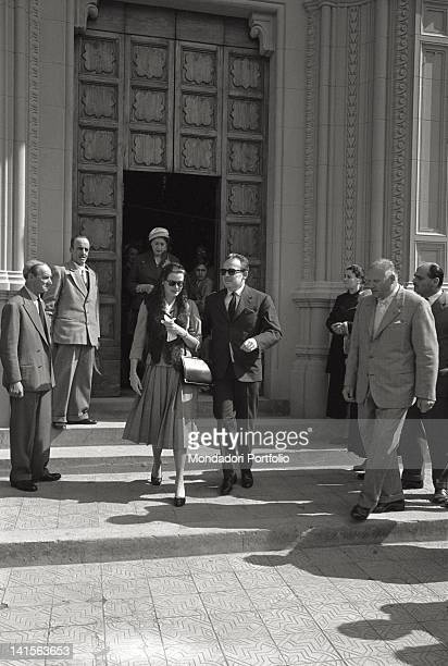 Prince Rainier III of Monaco and his wife Grace Kelly are going out of the church of St Anthony of Padua in Montecatini after a Mass Montecatini is...