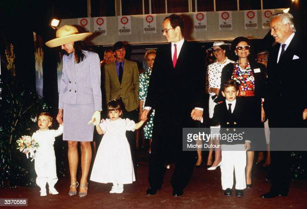 Prince Rainier III of Monaco arrives with daughter Princess Caroline's family and son Prince Albert at Fontvielle for the Flower Show in April 1989...