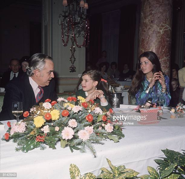 Prince Rainier III of Monaco at dinner with Princess Caroline and Princess Stephanie his daughters by former actress Grace Kelly