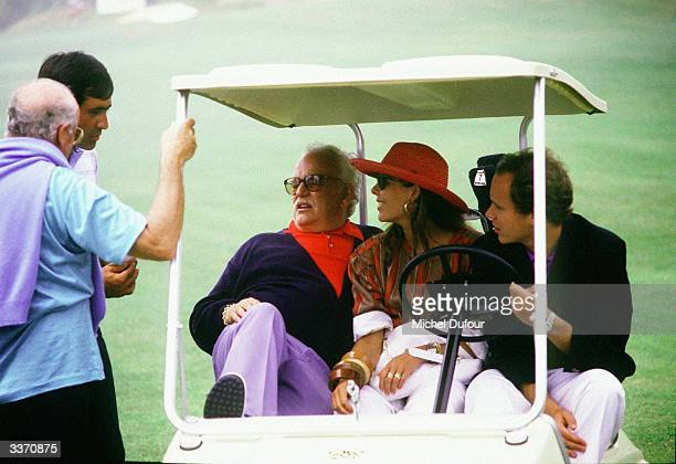 Prince Rainier III of Monaco chatting with Seve Ballesteros in the cab with Princess Caroline and Prince Albert at Monaco golf de Montagel in 1983 in...