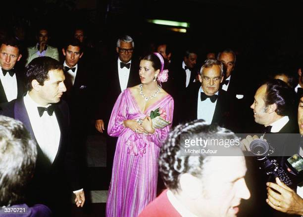 Prince Rainier III of Monaco hosting Prince Charles with Princess Caroline and film actor Cary Grant outside the 'Hotel de Paris' in 1983 in Paris...
