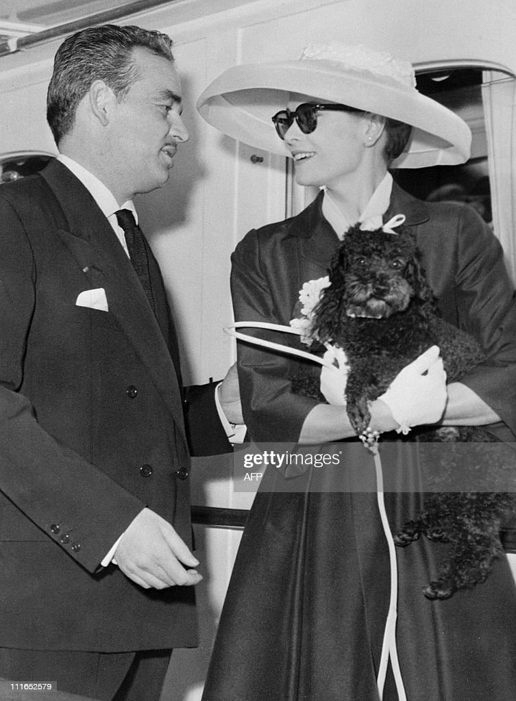 Prince Rainier III of Monaco joins his fiancee US actress Grace Kelly, holding her dog Oliver, aboard the princely yacht 'Deo Juvante II' on April 12, 1956 in Monte Carlo's harbour, while Grace Kelly arrives from USA for their wedding ceremony, planned on April 19, 1956.