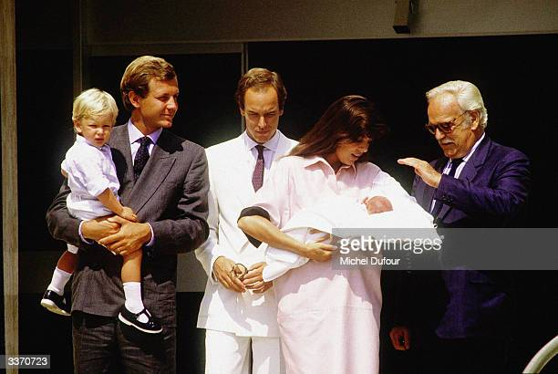 Prince Rainier III of Monaco poses for the birth of Princess Caroline's baby Charlotte Casiraghi as Stefano Casiraghi with son Andrea and Prince...