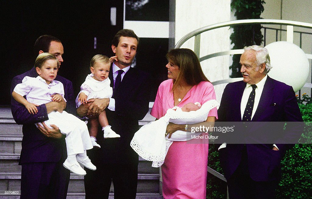 Prince Rainier III of Monaco poses for the birth of Princess Caroline's baby Pierre Casiraghi as Prince Albert stands with her other son Andrea and husband Stefano Casiraghi stands with daughter Charlotte at the Princess Grace Hospital in 1987 in Monte Carlo, Monaco.