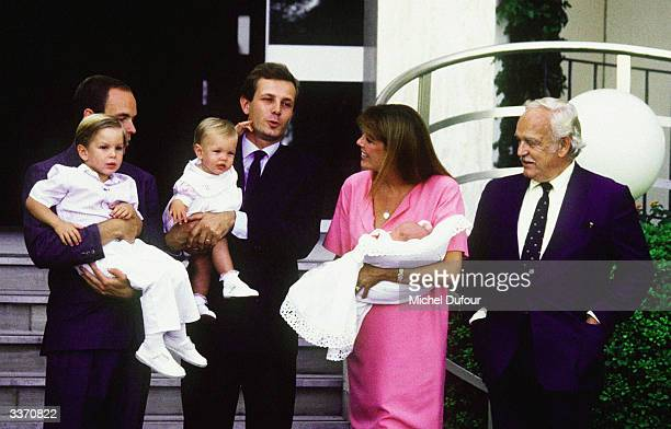 Prince Rainier III of Monaco poses for the birth of Princess Caroline's baby Pierre Casiraghi as Prince Albert stands with her other son Andrea and...