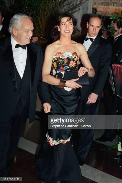 Prince Rainier III of Monaco, Princess Caroline of Monaco and Prince Albert II of Monaco attend the 33th Rose Ball on March 12, 1994 in Monaco,...