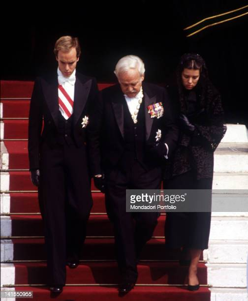 Prince Rainier III of Monaco taking part to the funeral of his wife the American actress Grace Kelly His children Caroline and Albert of Monaco...