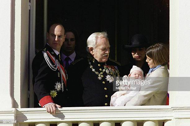 Prince Rainier III of Monaco waves from the balcony of the palace with his son Prince Albert celebrating principality's National Day on November 19...