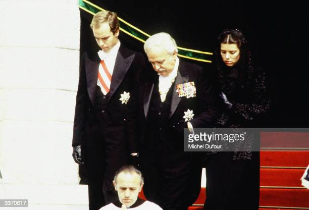 Prince Rainier III of Monaco with his children Prince Albert and Princess Caroline at his wife Princess Grace Kelly funeral on September 18 1982 at...