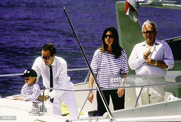 Prince Rainier III of Monaco with his children Princess Caroline and her son Andrea with son Prince Albert also on board watch the Offshore Race in...