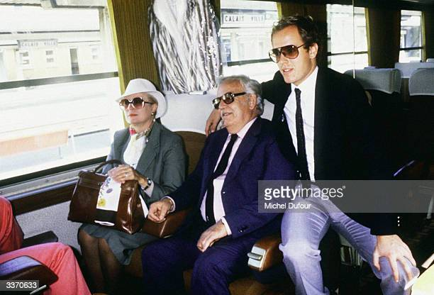 Prince Rainier III of Monaco with Princess Grace Kelly and son Prince Albert at the North Station before going to a cruise to the North Pole in Monte...