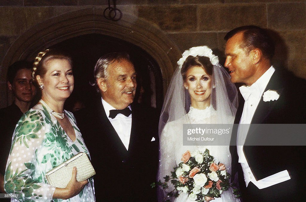 Prince Rainier III of Monaco with wife Princess Grace Kelly posing at the wedding of her brother Jack Kelly in 1981 in Philadelphia, Pennsylvania.
