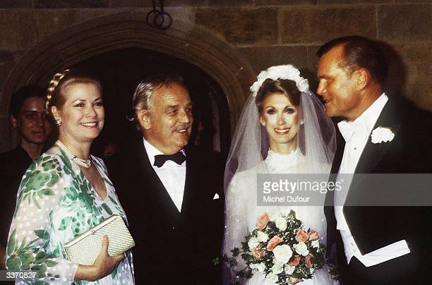 Prince Rainier III of Monaco with wife Princess Grace Kelly posing at the wedding of her brother Jack Kelly in 1981 in Philadelphia Pennsylvania