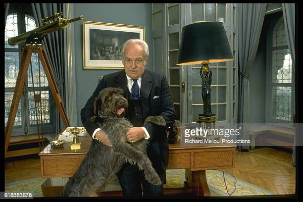 Prince Rainier in his office with his dog.